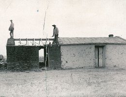 Building a Sod House in Western Nebraska; home of Frank Roach, Keith County, about 1890