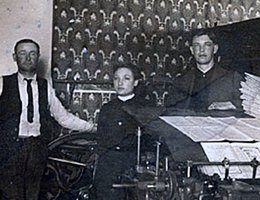 Perkins used this printing press to run his mail order and newspaper businesses; (left to right): Fred Wixson, Ada Converse, Edwin E. Perkins (also in the inset)