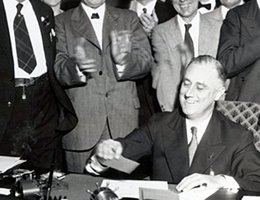 President Franklin D. Roosevelt signing the Tennessee Valley Authority Act in 1933