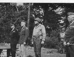 Gen. Dwight Eisenhower (from left), Gen. Baade, Col. Miltonberger, General Patton, and an aide review the 134th in Cornwall, England; June 1944