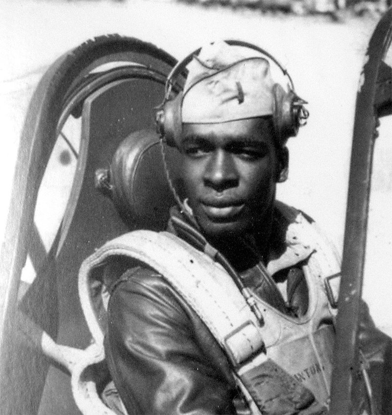 Lieutenant Colonel Paul Adams, Tuskegee Airman, 302nd Fighter Squadron, in the cockpit of his P40 plane