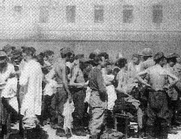 Long provided this photo of concentration camp victims lining up to receive clean, new clothes after the Allies liberated their camp