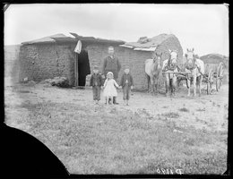 George Barnes with three motherless children and a caved-in soddy, 1887