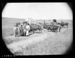 Emigrants in a wagon train arrive at the Gates Post Office in Custer County, 1886